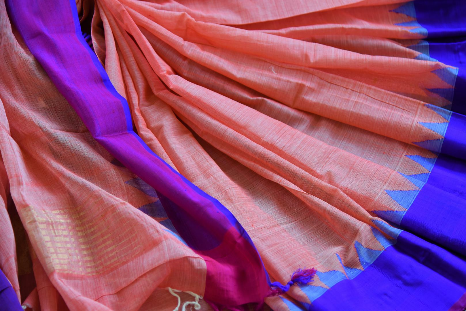 Buy pink ikat khaddi sari online in USA with blue border. Pure Elegance clothing store brings an alluring collection of ethnic Indian ikkat saris in USA for women. -details