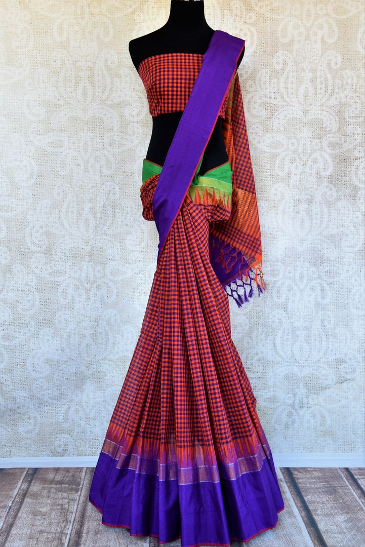 Buy orange checked ikat khaddi sari online in USA with blue border. Pure Elegance clothing store brings an alluring collection of Indian ikkat saris in USA for women. -full view