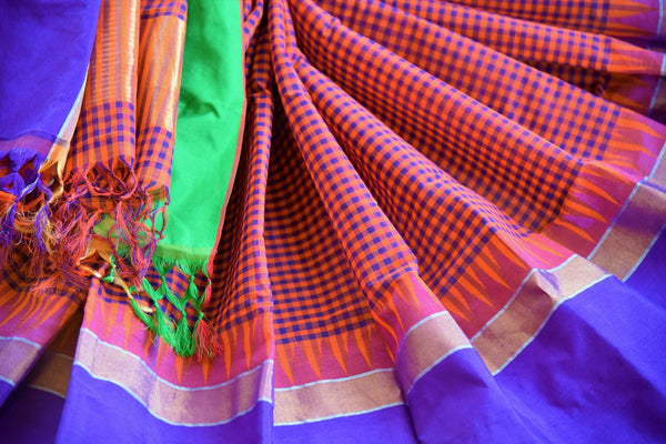 Buy orange checked ikat khaddi sari online in USA with blue border. Pure Elegance clothing store brings an alluring collection of Indian ikkat saris in USA for women. -details