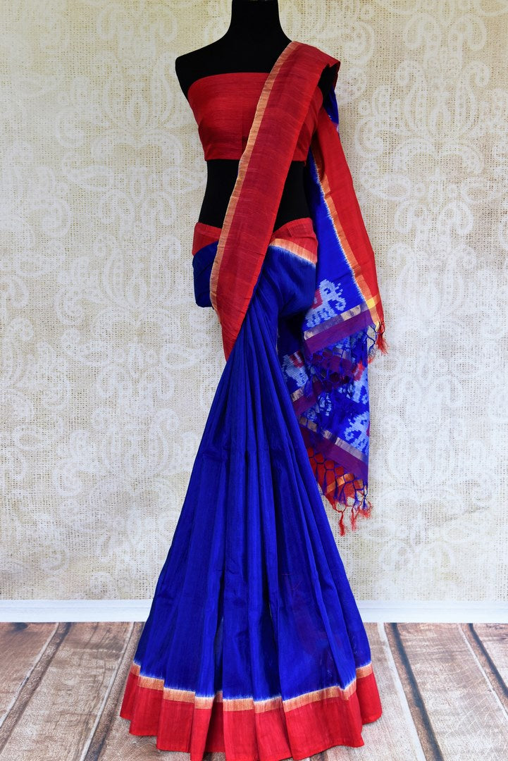Elegant blue linen saree with ikkat pallu for online shopping in USA. Pure Elegance clothing store brings an exquisite range of ethnic Indian sarees in USA for women. -full view