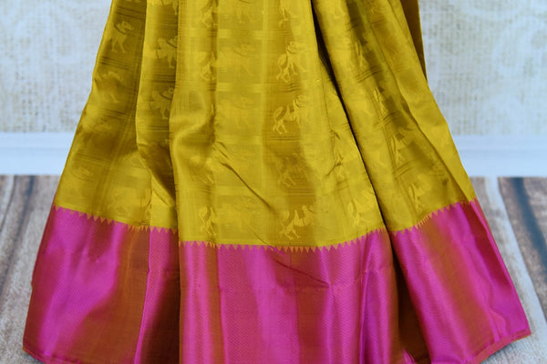 Buy yellowish green Kanchipuram silk saree online in USA. Pure Elegance clothing store brings an exquisite range of Indian silk sarees in USA for women. Shop online.-pleats
