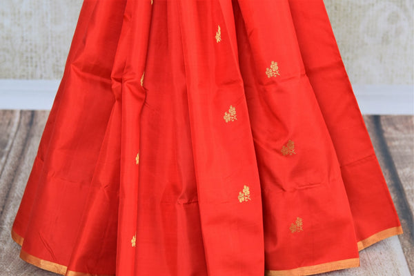 Buy red Kanjeevaram silk saree online in USA with black zari pallu. Pure Elegance fashion store brings an exclusive range of  Indian Kanchipuram silk sarees in USA.-pleats