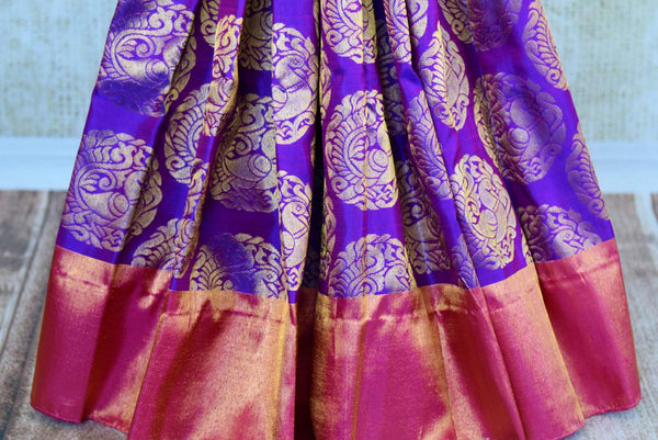 Buy green and purple Kanchipuram silk saree online in USA. Pure Elegance clothing store brings an exquisite range of Indian Kanjivaram silk sarees in USA for women. -pleats