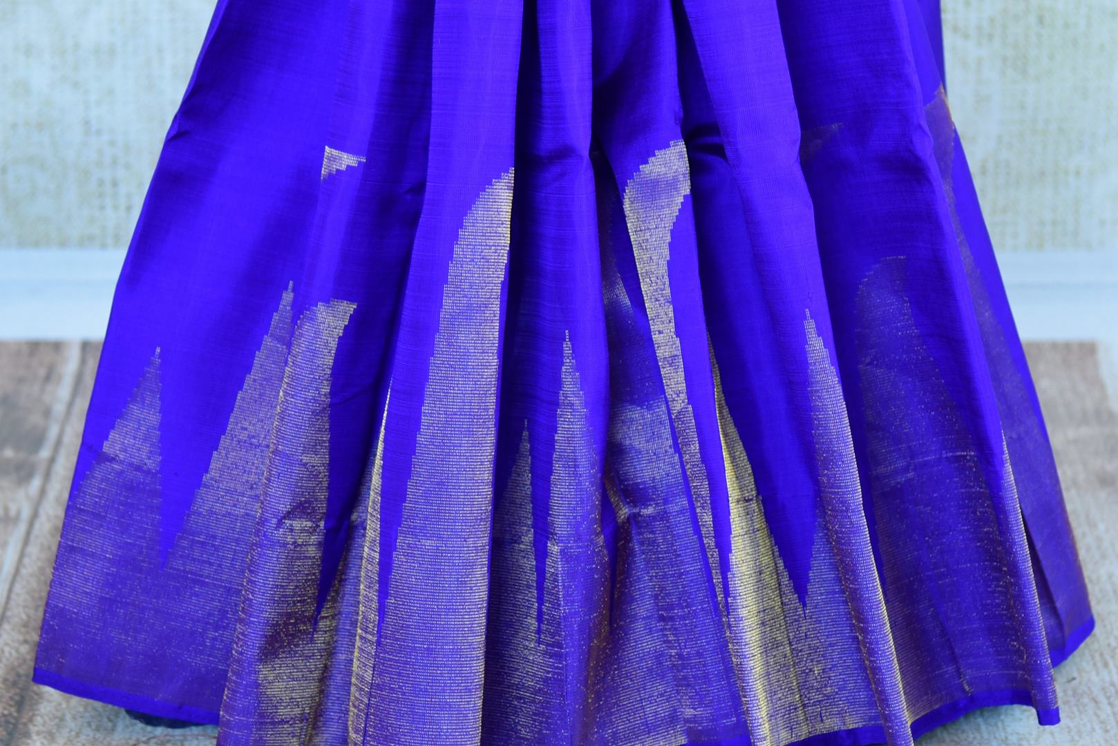 Buy blue Kanchipuram silk saree online in USA. Pure Elegance clothing store brings an exquisite range of Indian Kanjivaram silk sarees in USA for women.  Shop online.-pleats