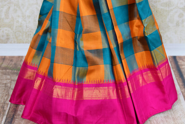 Buy orange and blue checker Kanjeevaram silk saree online in USA. Explore a range of exquisite Indian Kanchipuram silk sarees in USA at Pure Elegance store or shop online. -pleats