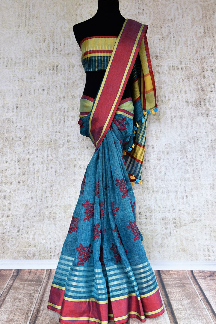 Buy blue embroidered linen saree online in USA with striped border. Pure Elegance fashion store brings an exclusive range of  Indian woven linen saris in USA. Shop now.-full view