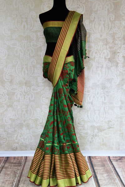 Buy green embroidered linen saree online in USA. Pure Elegance fashion store brings an exqusite range of  Indian woven Linen saris in USA for women. Shop online.-full view