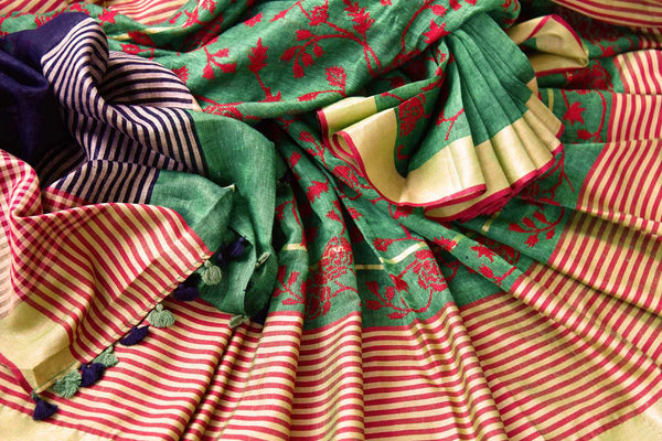 Buy green embroidered linen saree online in USA. Pure Elegance fashion store brings an exqusite range of  Indian woven Linen saris in USA for women. Shop online.-details