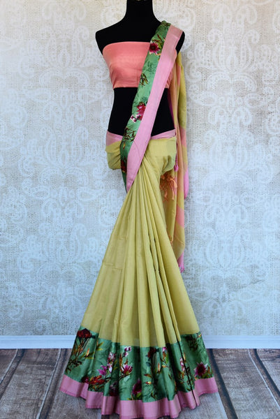 Buy cream linen saree online in USA with green printed border. Explore a collection of exquisite Indian linen sarees in USA at Pure Elegance store or shop online. -full view