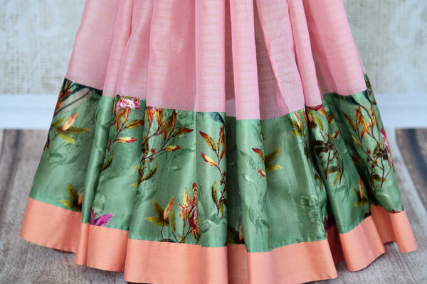 Buy pink linen sari online in USA with green printed border. Explore a collection of exquisite Indian linen sarees in USA at Pure Elegance store or shop online. -pleats