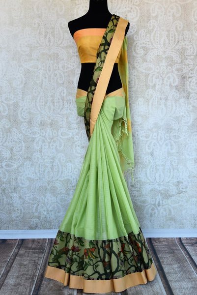 Buy elegant green linen sari online in USA with printed border. Explore a collection of exquisite Indian linen sarees in USA at Pure Elegance store or shop online. -full view