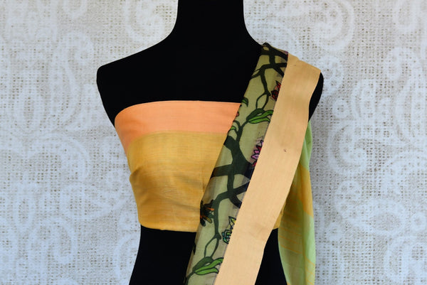 Buy elegant green linen sari online in USA with printed border. Explore a collection of exquisite Indian linen sarees in USA at Pure Elegance store or shop online. -blouse pallu