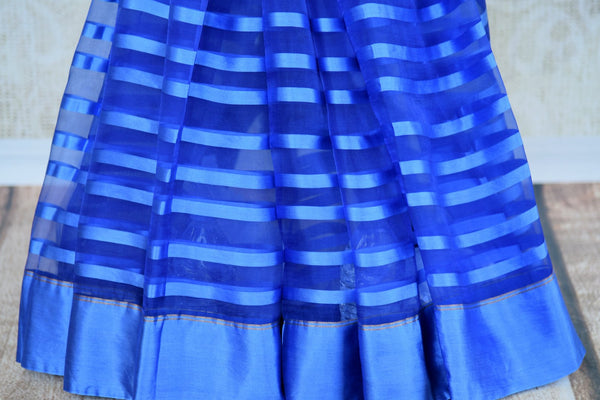 Buy blue tissue silk saree online in USA with Banarasi blouse piece. Explore a range of  Indian traditional handloom saris at Pure Elegance online store in USA. -pleats