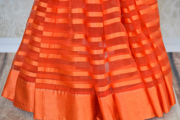 Buy orange tissue silk saree online in USA with Banarasi blouse piece. Explore a range of  Indian traditional handloom sarees at Pure Elegance online store in USA. -pleats