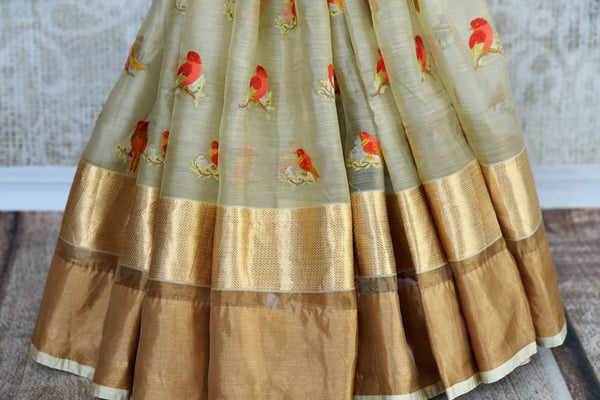 Buy beige embroidered chanderi silk saree online in USA with golden border. Explore a collection of exquisite Indian chanderi sarees in USA at Pure Elegance store or shop online. -pleats