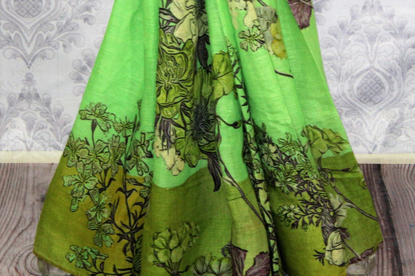 Green floral print linen saree buy online in USA. Pure Elegance clothing store brings a stunning collection of Indian printed linen sarees in USA for women. Shop online.-pleats