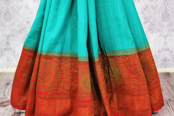 Blue Muga Banarasi sari buy online in USA with zari border. Pure Elegance fashion store brings an alluring range of Indian designer sarees in USA for women. Shop online.-pleats