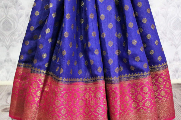 Blue Muga Banarasi sari for online shopping in USA. Pure Elegance fashion store brings an alluring range of exquisite Indian handloom sarees in USA for women. -pleats