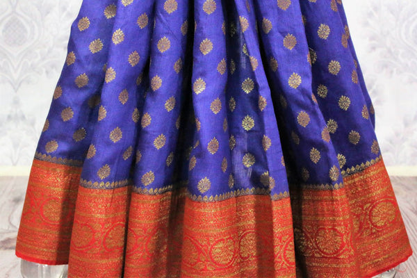Traditional dark blue Muga Banarasi saree for online shopping in USA. Pure Elegance fashion store brings an alluring range of exquisite Indian handloom sarees in USA for women. -pleats