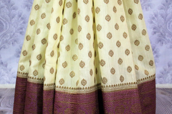 Cream Muga Banarasi saree with buta for online shopping in USA. Pure Elegance fashion store brings an alluring range of exquisite Indian handloom saris in USA for women. -pleats