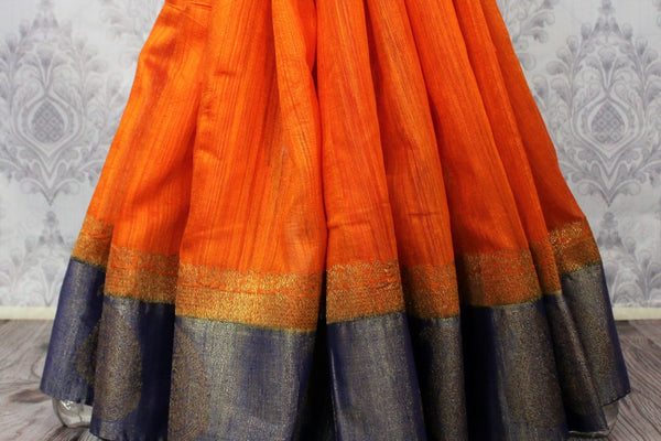 Buy orange tussar Banarasi sari online in USA with blue border. Browse through a range of exclusive Indian designer sarees in USA at Pure Elegance online store. Shop now.-pleats