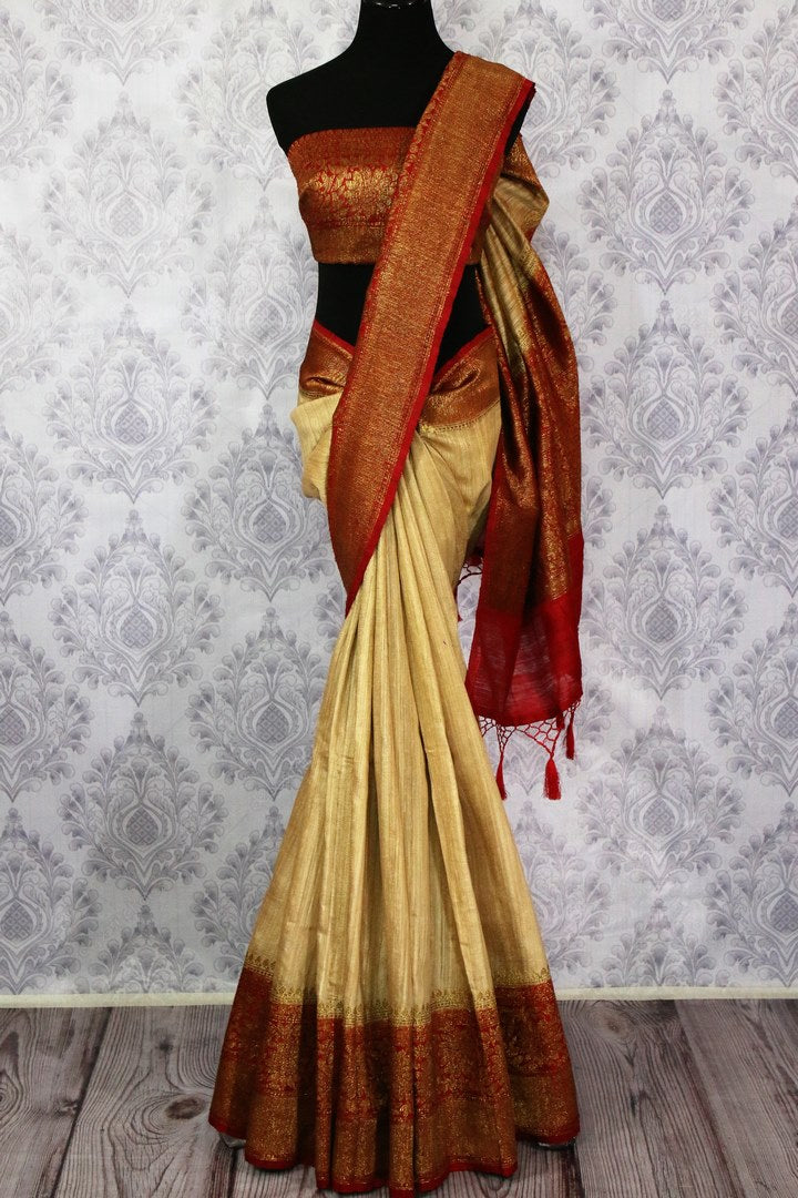 Buy beige tussar Banarasi saree online in USA with red border. Browse through a range of exclusive Indian handloom sarees in USA at Pure Elegance online store.-full view