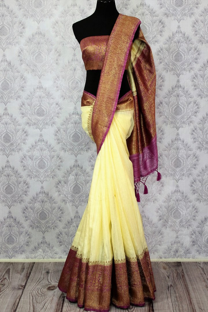 Buy cream Banarasi tussar saree online in USA with purple border. Browse through a range of traditional Indian saris in USA at Pure Elegance online store. Shop now.-full view