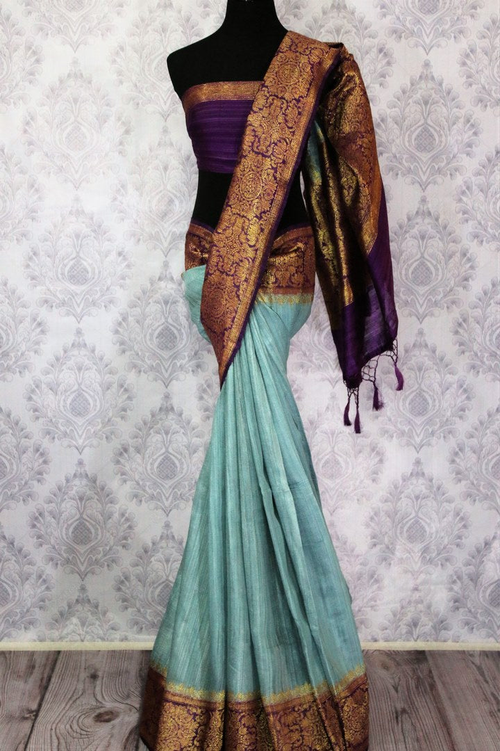 Buy sky blue Benarasi tussar saree online in USA with purple border. Browse through a range of traditional Indian saris in USA at Pure Elegance online store. Shop now.-full view