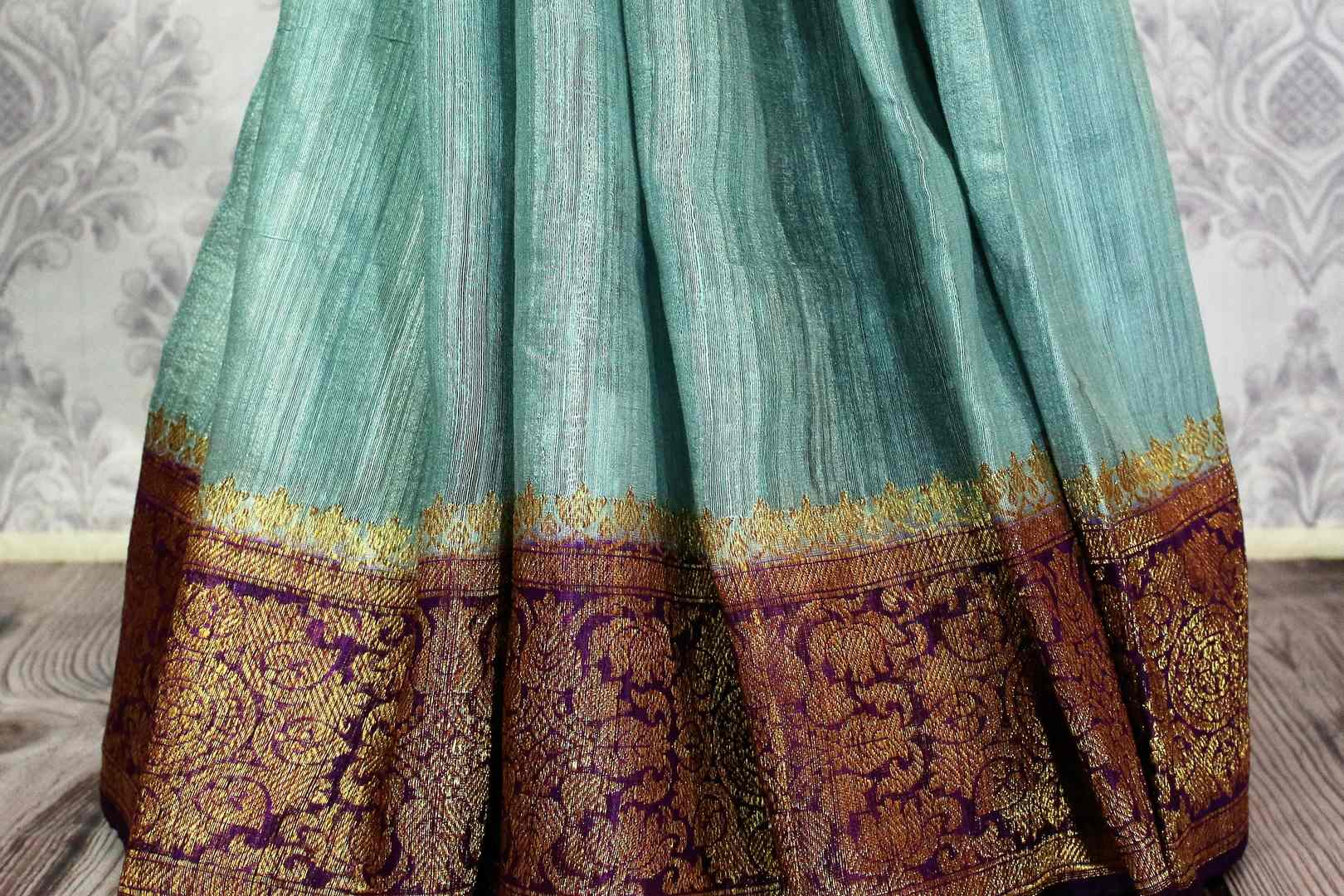 Buy sky blue Benarasi tussar saree online in USA with purple border. Browse through a range of traditional Indian saris in USA at Pure Elegance online store. Shop now.-pleats