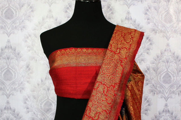 Buy blue Benarasi tussar saree online in USA with red border. Browse through a range of traditional Indian sarees for weddings at Pure Elegance online store. Shop now.-blouse pallu