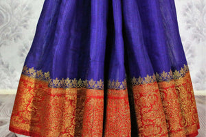 Buy blue Benarasi tussar saree online in USA with red border. Browse through a range of traditional Indian sarees for weddings at Pure Elegance online store. Shop now.-pleats