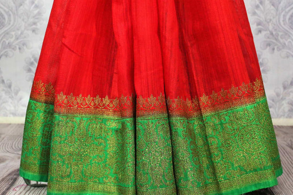Buy red Banarasi tussar saree online in USA with green border. Browse through a range of traditional Indian sarees for weddings at Pure Elegance online store. Shop now.-pleats