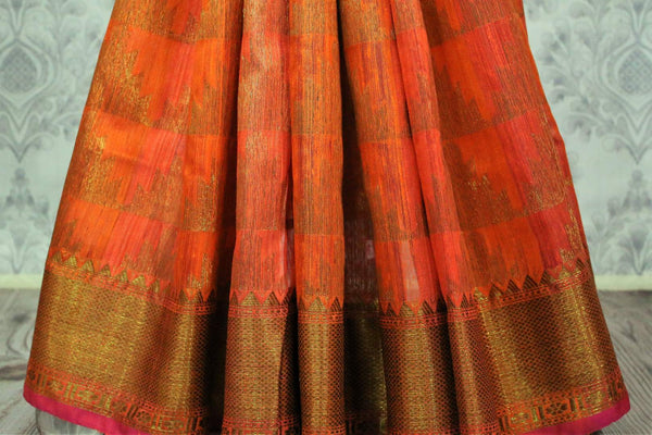 Orange Banarasi tussar saree buy online in USA with gold border. Browse through a range of traditional Indian sarees for parties at Pure Elegance online store. -pleats
