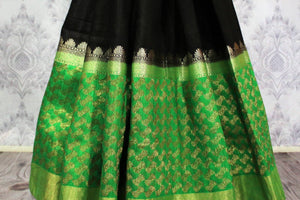 Shop black tussar Banarasi saree online in USA with green border. Explore a range of Indian wedding sarees in USA at Pure Elegance online or visit our store in USA.-pleats