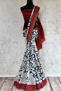 Buy dark blue printed tussar silk saree online in USA. Pure Elegance clothing store brings an exquisite collection of Indian designer saris in USA for women. Shop online.-full view