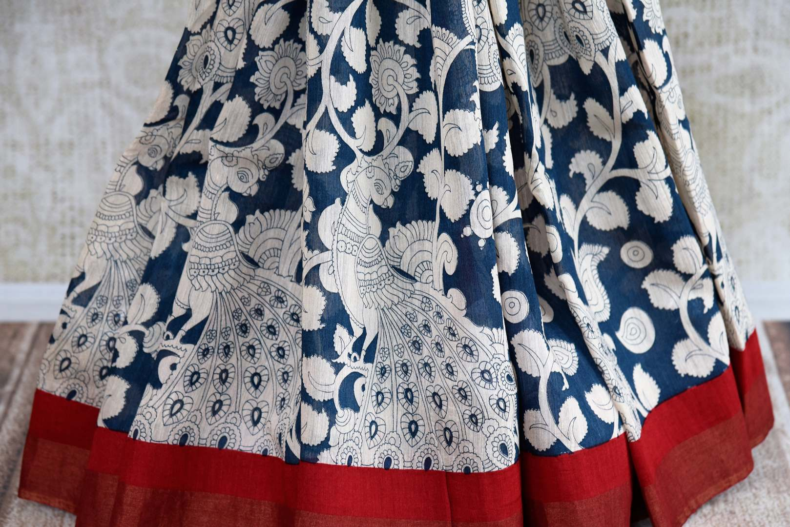 Buy dark blue printed tussar silk saree online in USA. Pure Elegance clothing store brings an exquisite collection of Indian designer saris in USA for women. Shop online.-pleats