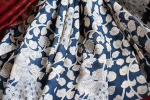 Buy dark blue printed tussar silk saree online in USA. Pure Elegance clothing store brings an exquisite collection of Indian designer saris in USA for women. Shop online.-details