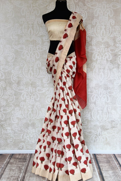 Buy off-white tussar silk saree online in USA with red floral print. Shop from a range of exclusive Indian silk saris at Pure Elegance online store or visit our store in USA.-full view