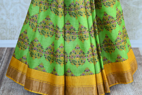 Buy light green tussar silk printed saree online in USA. Pure Elegance clothing store brings an exquisite collection of Indian designer sarees in USA for women. -pleats