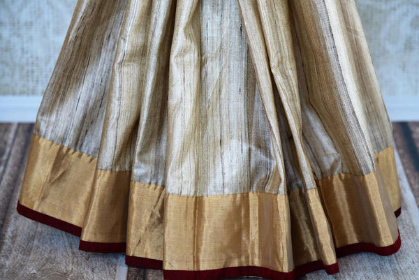 Buy gold and black half tussar silk half kalamkari print sari online in USA. Explore from a range of exquisite Indian silk sarees in USA at Pure Elegance store or shop online.-pleats