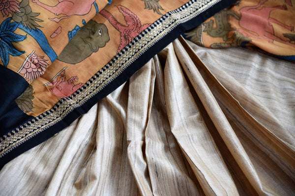 Buy beige half kalamkari print and half plain silk sari online in USA with embroidery. Pure Elegance clothing store brings exquisite range of Indian sarees in USA for women.-details