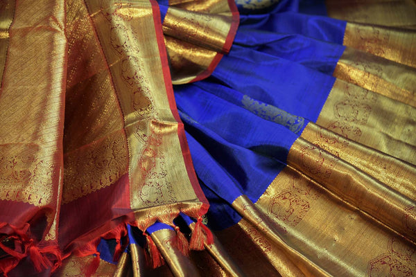 Buy blue Kanchipuram silk saree with zari border and buta online in USA. Choose from a range of exquisite Indian sarees at Pure Elegance fashion store in USA. -details