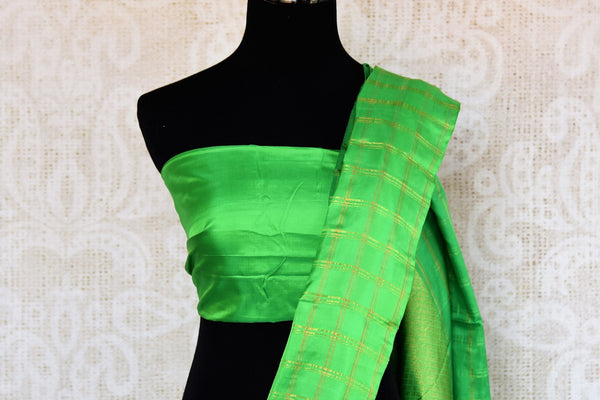 Buy online white Kanchipuram silk saree in USA. Pure Elegance clothing store brings an exquisite collection of Indian Kanjeevaram sarees for online shopping in USA.  -blouse pallu
