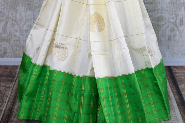Buy online white Kanchipuram silk saree in USA. Pure Elegance clothing store brings an exquisite collection of Indian Kanjeevaram sarees for online shopping in USA.  -pleats