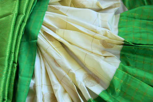 Buy online white Kanchipuram silk saree in USA. Pure Elegance clothing store brings an exquisite collection of Indian Kanjeevaram sarees for online shopping in USA.  -details