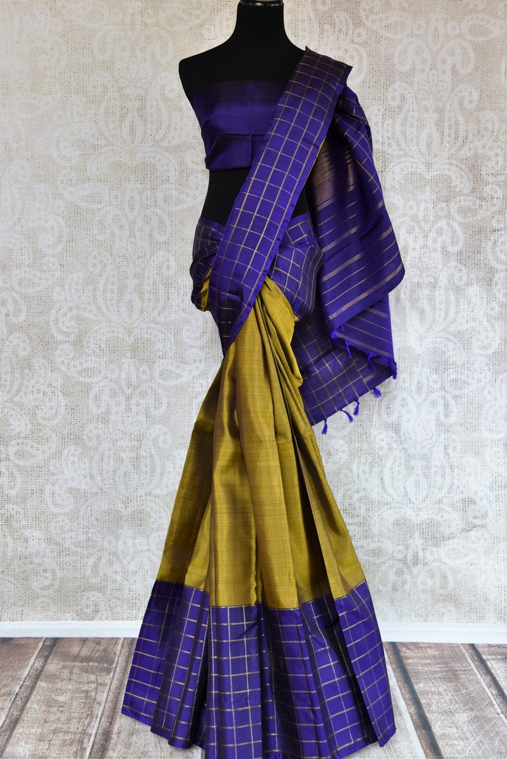 Shop green Kanjeevaram silk saree with check border online in USA. Choose from a range of exquisite silk sarees at Pure Elegance Indian clothing store in USA. Shop now.-full view