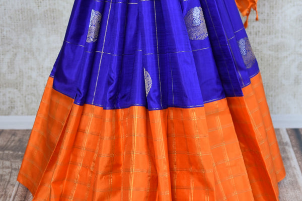 Buy online blue and orange Kanchipuram silk saree in USA. Pure Elegance clothing store brings an exquisite range of Indian Kanjeevaram saris for online shopping in USA.  -pleats