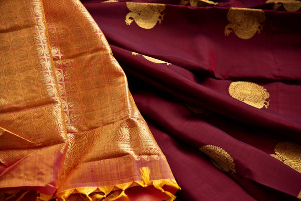 Buy maroon Kanchipuram silk saree with peacock zari buta online in USA. Explore from a range of exclusive Indian sarees at Pure Elegance clothing online store..-details