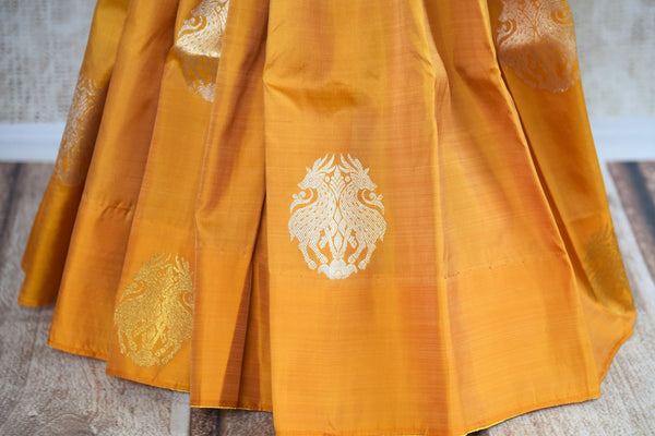 Buy yellow Kanchipuram silk saree with zari buta online in USA. Explore from a range of exclusive Indian silk sarees at Pure Elegance clothing online store for women.-pleats