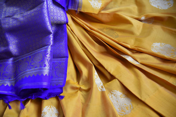 Buy yellow Kanchipuram silk saree with zari buta online in USA. Explore from a range of exclusive Indian silk sarees at Pure Elegance clothing online store for women.-details